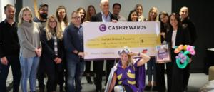 Cashrewards founder presenting a cheque to the Starlight Foundation