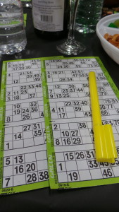 Bingo cards and markers are provided