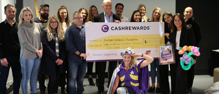 Cashrewards founder presenting a cheque to the Starlight Foundation